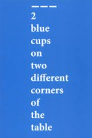 2 blue cups on two different corners of the table