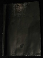 small blackened book 1
