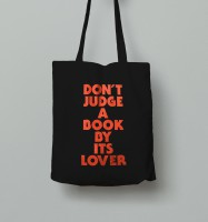 'DON'T JUDGE A BOOK BY ITS LOVER' (tote bag)